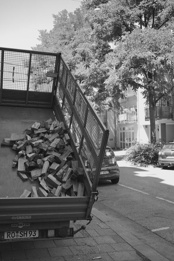Firewood delivery in the center of the City of Munich, tagged with urban, black & white, geotagged