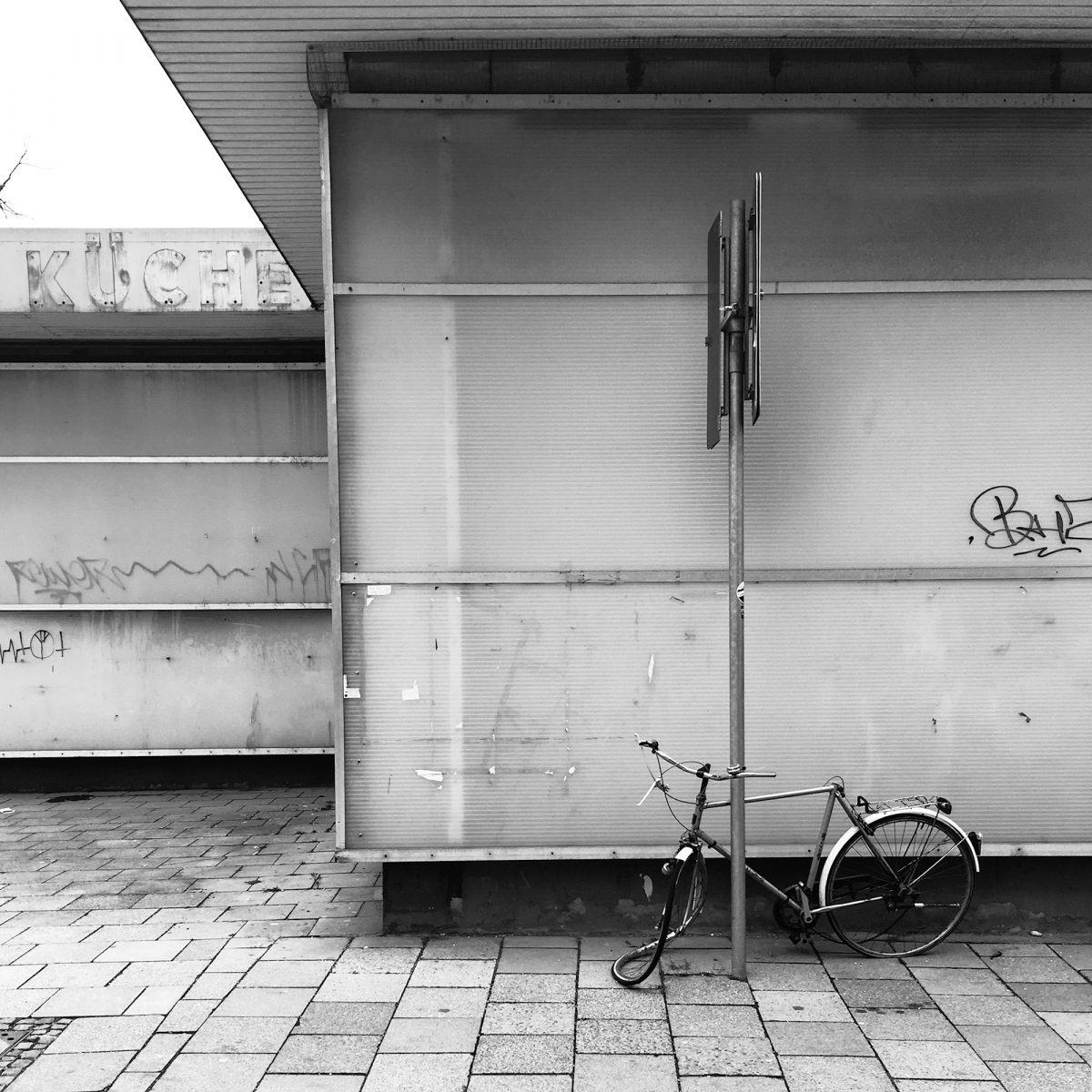 Decommisioned - Building and Bicycle, Karlstraße, Munich, geotagged, Black & White, Graffiti, Phone Camera, Urban